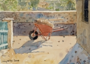 Red Wheelbarrow in Sunlight
